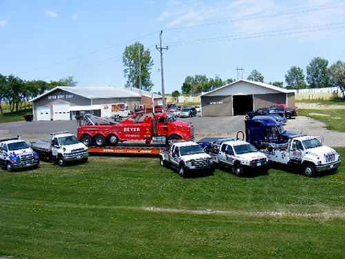 Arial shot of beyer towing trucks