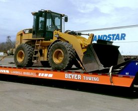 Skid Steer on Beyer towing flatbed