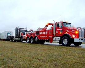 Beyer Towing Tow Truck hauling Semi