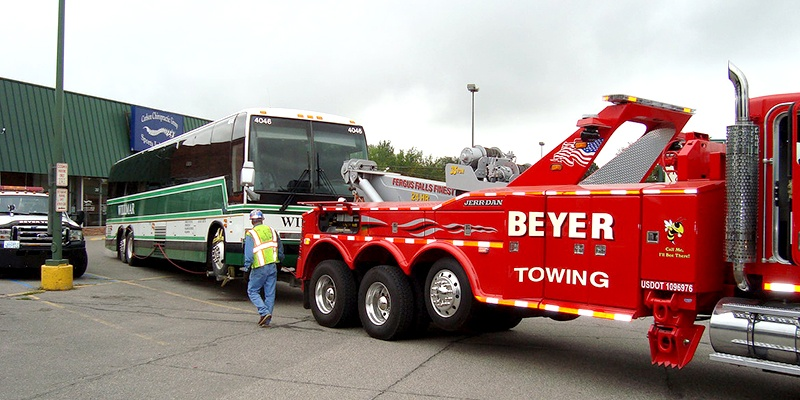 Beyer Towing hauling large charter bus