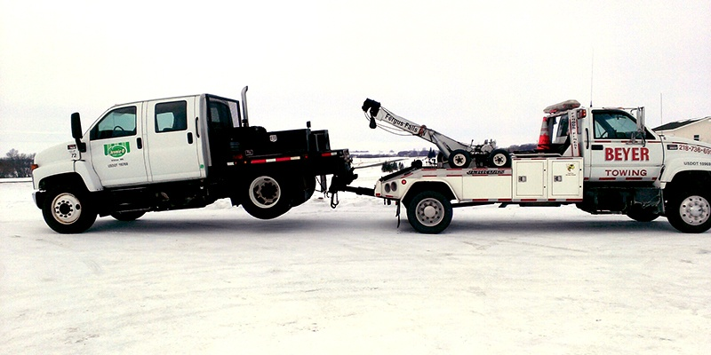 Beyer towing tow truck hauling medium size truck